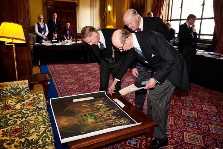 UGLE's Grand Master, HRH The Duke of Kent, inspects the gifts under the guidance of Diane Clements, Director of The Library and Museum of Freemasonry (r)